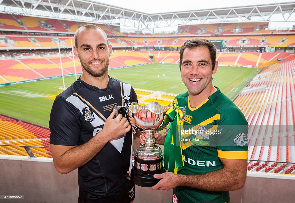 New Zealand captain Simon Mannering and Australian captain Cameron Smith pose with trophy ahead of the International Test match during a press conference at Suncorp Stadium on April 30, 2015 in Brisbane, Australia.