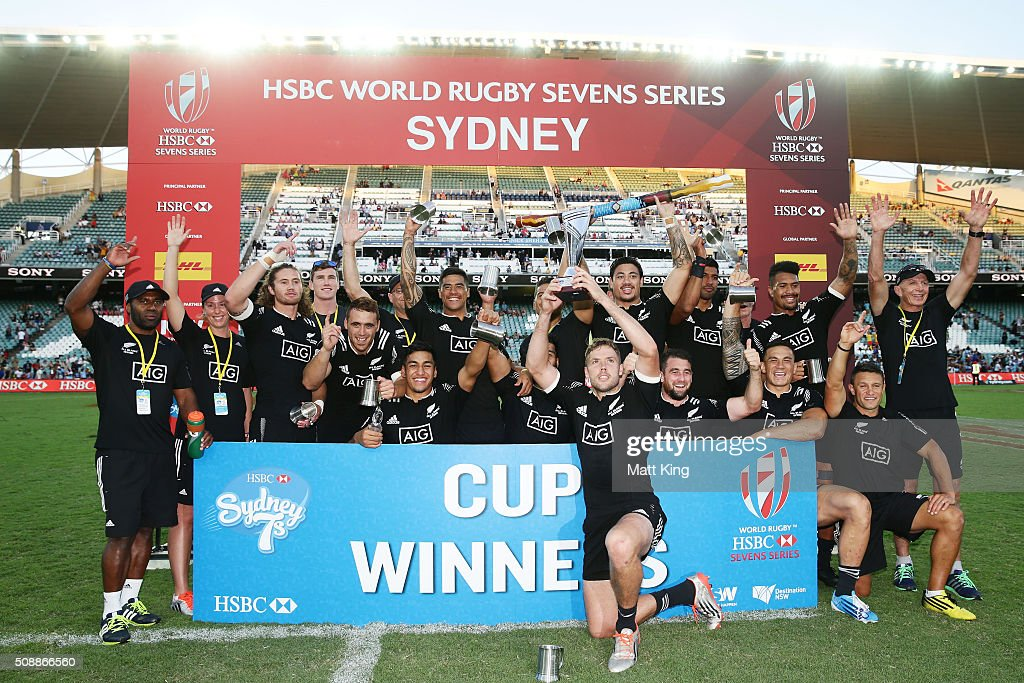 New Zealand celebrate and pose with the winners trophy after winning the 2016 Sydney Sevens Cup Final match against Australia at Allianz Stadium on February 7, 2016 in Sydney, Australia.