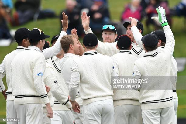 New Zealand celebrate South Africa's Hashim Amla being caught during day four of the 1st International cricket test match between New Zealand and...