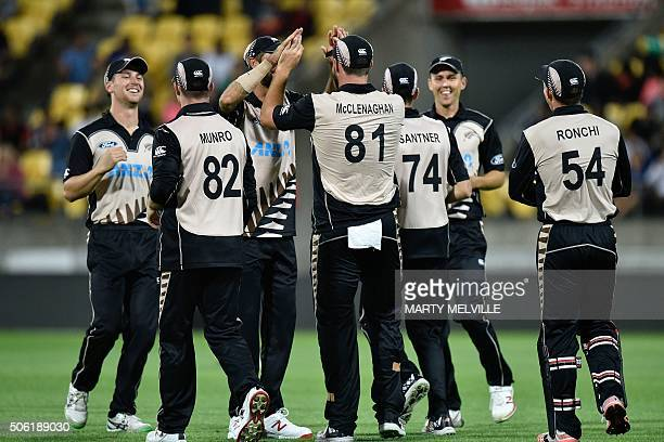 New Zealand celebrate the wicket of Shoaib Malik of Pakistan during the third T20 cricket match between New Zealand and Pakistan at Westpac Stadium...