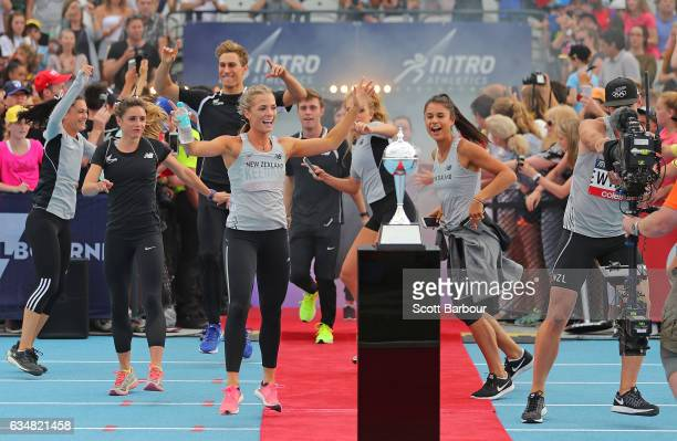 New Zealand celebrate with supporters in the crowd as they run onto the track during the Melbourne Nitro Athletics Series at Lakeside Stadium on...