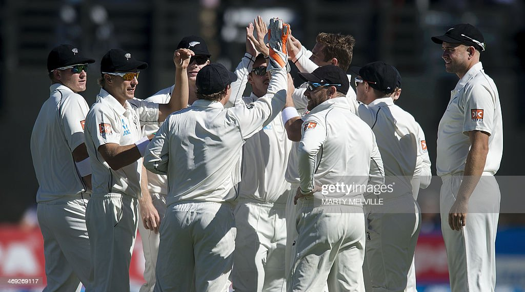 New Zealand celebrates Murali Vijay of India being caught out on the first day of the second cricket Test between New Zealand and India in Wellington on February 14, 2014.