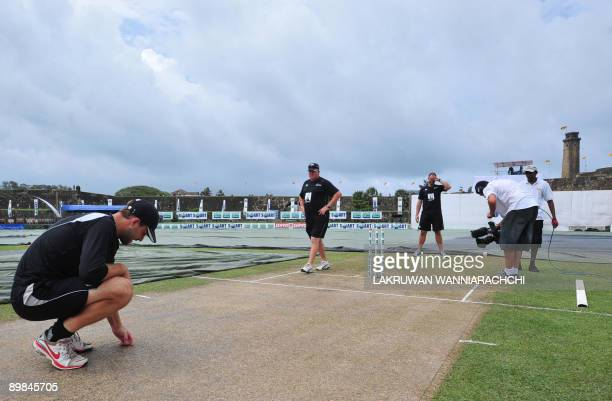 New Zealand cricket captain Daniel Vettori inspects the pitch before the opening Test match between Sri Lanka and New Zealand at The Galle...