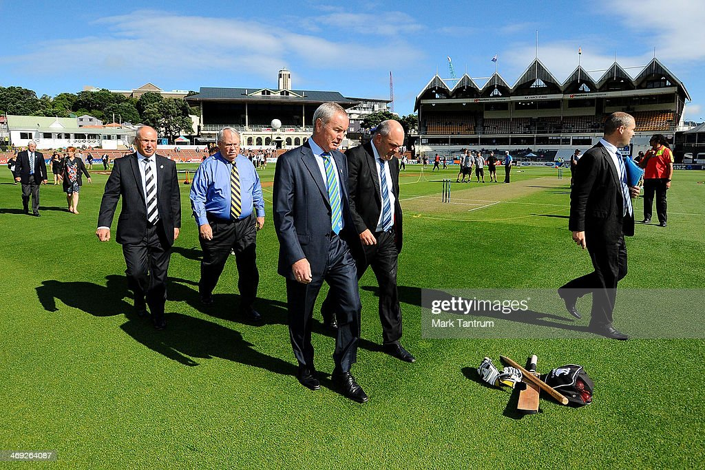 New Zealand Cricket CEO David White, Sky TV CEO John Fellet, ICC President Alan Isaac and Steven Joyce walk onto the field for the ICC Cricket World Cup 'One Year To Go' on February 14, 2014 in Wellington, New Zealand.