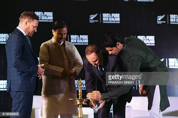 New Zealand cricketer Brendon McCullum and India Tourism and Cultural Minister Mahesh Sharma watch as Indian actor and Tourism New Zealand Brand...