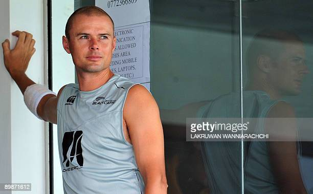 New Zealand cricketer Chris Martin watches from the balcony dressing room during the second day of the first Test match between Sri Lanka and New...
