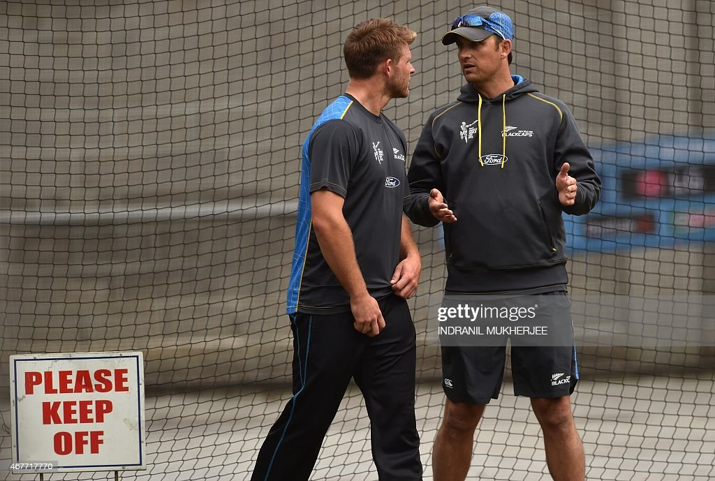 New Zealand cricketer Corey Anderson listens to bowling coach Shane Bond during a training session at the Melbourne Cricket Ground ahead the 2015...