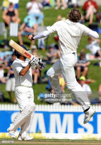 New Zealand cricketer Iain O'Brien celebrates the wicket of Indian batsman Sachin Tendulkar during the third day of the first Test match between...