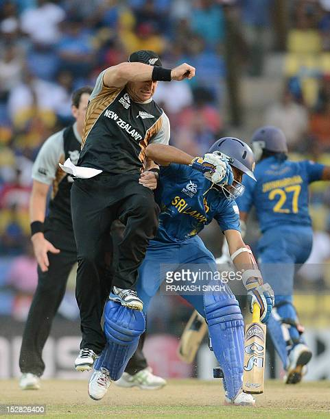 New Zealand cricketer Nathan McCullum collides with Sri Lankan cricketer Tilakaratne Dilshan during the ICC Twenty20 Cricket World Cup's Super Eight...