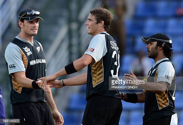New Zealand cricketer Tim Southee celebrates the wicket of West Indies cricketer Darren Samy with teammates during the ICC Twenty20 Cricket World...