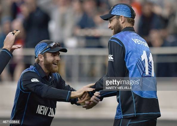 New Zealand Daniel Vettori celebrates catching West Indies' batsman Marlon Samuels with teammate Kane Williamson during the Cricket World Cup Quarter...