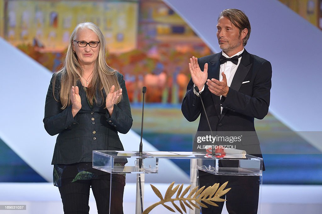New Zealand director and President of the Cinefondation and Short Films Jury Jane Campion (L) and Danish actor Mads Mikkelsen applaud on May 26, 2013 after handing the Palme d'Or for Best Short Film to 'Safe' during the closing ceremony of the 66th edition of the Cannes Film Festival in Cannes. AFP PHOTO / ALBERTO PIZZOLI