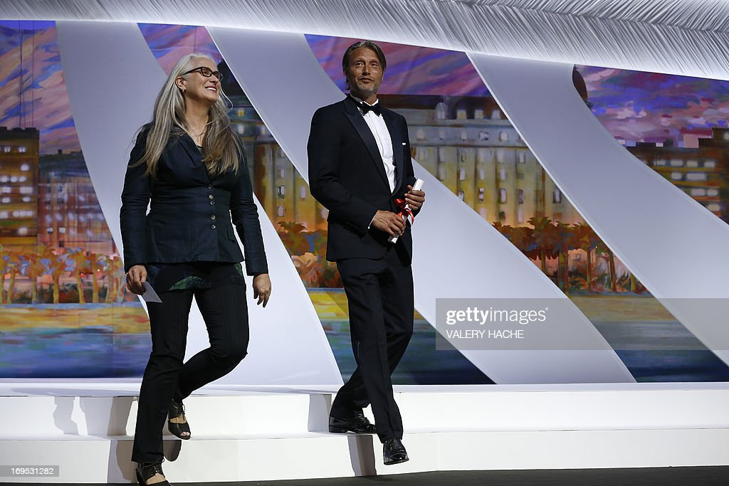 New Zealand director and President of the Cinefondation and Short Films Jury Jane Campion (L) and Danish actor Mads Mikkelsen arrive on May 26, 2013 to hand the Palme d'Or for Best Short Film during the closing ceremony of the 66th edition of the Cannes Film Festival in Cannes. AFP PHOTO / VALERY HACHE