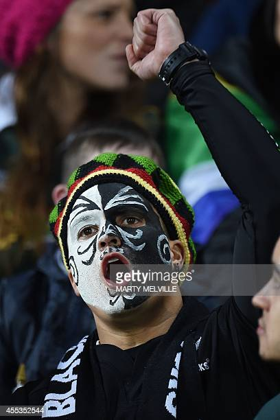 A New ZEaland fan celebrates a try during the Rugby Championship Test between New Zealand and South Africa at Westpac Stadium in Wellington on...