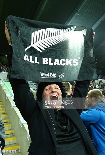 New Zealand fan cheers on the All Blacks during the 2015 Rugby World Cup Pool C match between New Zealand and Tonga at St James' Park on October 9...