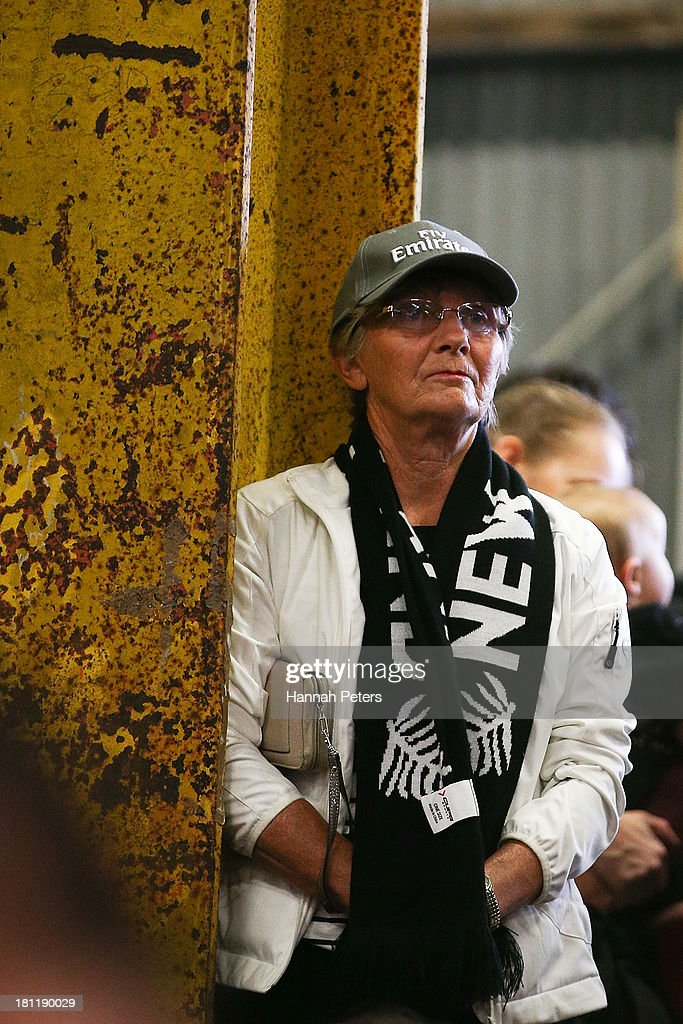 A New Zealand fan watches race 12 of the America's Cup between Emirates Team New Zealand and Oracle Team USA at Shed 10 on September 20, 2013 in Auckland, New Zealand.