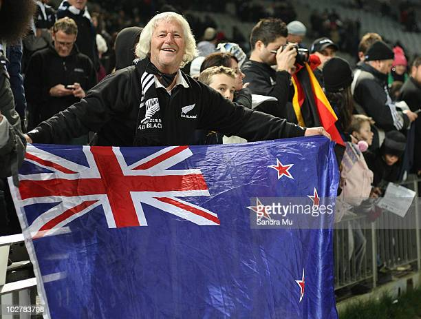 New Zealand fan waves the flag during the TriNations match between the New Zealand All Blacks and South Africa Springboks at Eden Park on July 10...