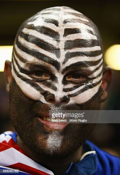 New Zealand fan with silver fern face paint looks forward to the action before the 2015 Rugby World Cup Quarter Final match between New Zealand and...
