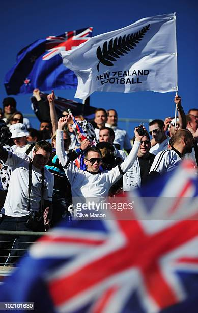 New Zealand fans celebrate as their team earn a draw in the 2010 FIFA World Cup South Africa Group F match between New Zealand and Slovakia at the...