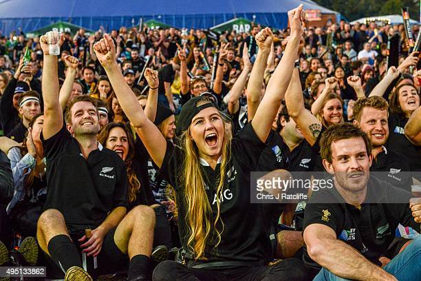 New Zealand fans celebrate the first try in the Rugby World Cup Final match between the New Zealand All Blacks and Australia Wallabies at Richmond...