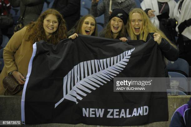 New Zealand fans cheer after the international rugby union test match between Scotland and New Zealand at Murrayfield stadium in Edinburgh on...