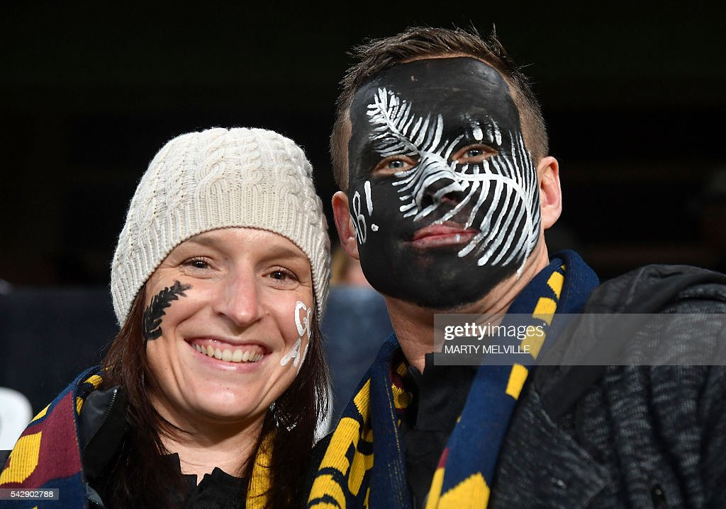 New Zealand fans pose during the third rugby Test match between the New Zealand All Blacks and Wales at Forsyth Barr Stadium in Dunedin on June 25, 2016. / AFP / Marty Melville