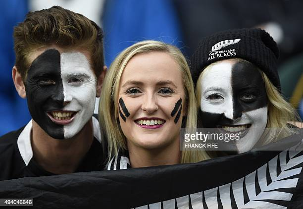 New Zealand fans pose prior to a semifinal match of the 2015 Rugby World Cup between South Africa and New Zealand at Twickenham Stadium southwest...