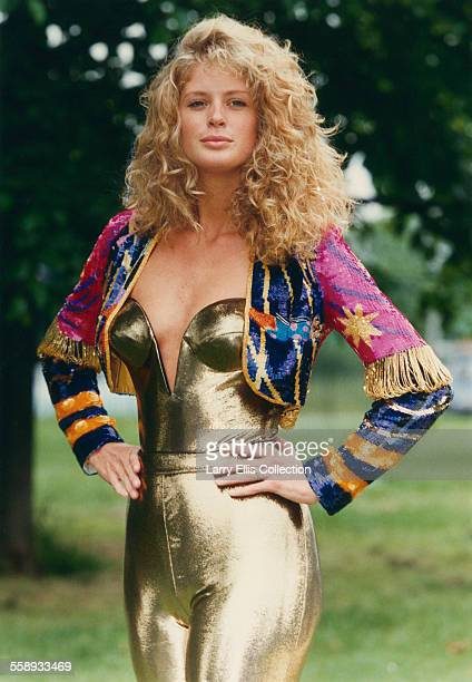 New Zealand fashion model Rachel Hunter the wife of singer Rod Stewart wearing a skintight gold onesie 1992