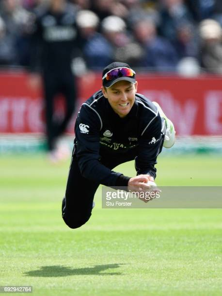 New Zealand fielder Trent Boult dives to catch England batsman Jake Ball during the ICC Champions Trophy match between England and New Zealand at...