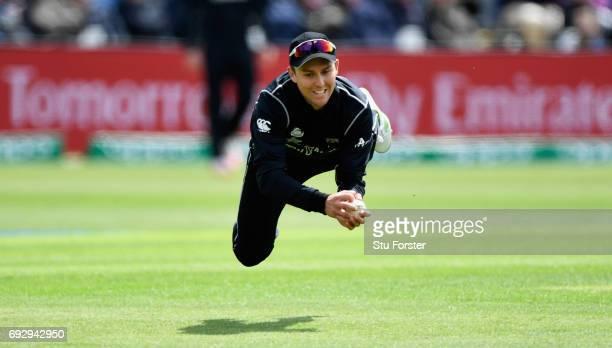New Zealand fielder Trent Boult dives to catch England batsman Jake Ball during the ICC Champions Trophy match between England and New Zealand at...