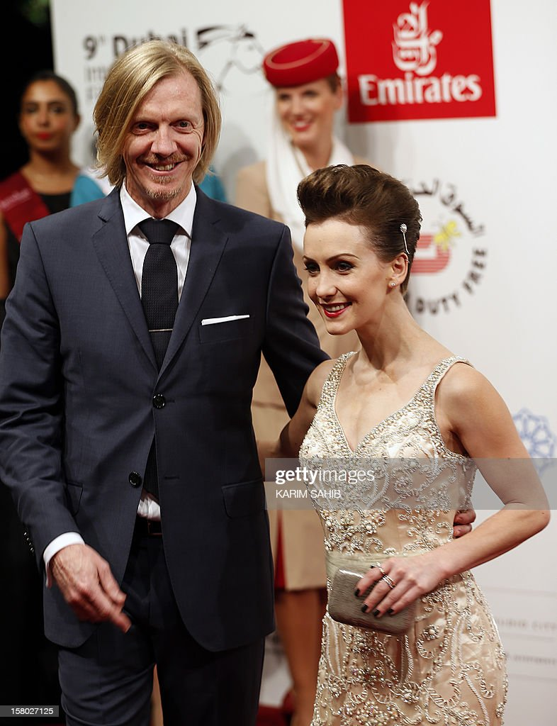 New Zealand film director Andrew Adamson (L) and actress Erica Linz attend the opening ceremony of the Dubai International Film Festival in the Gulf emirate of Dubai on December 9, 2012.
