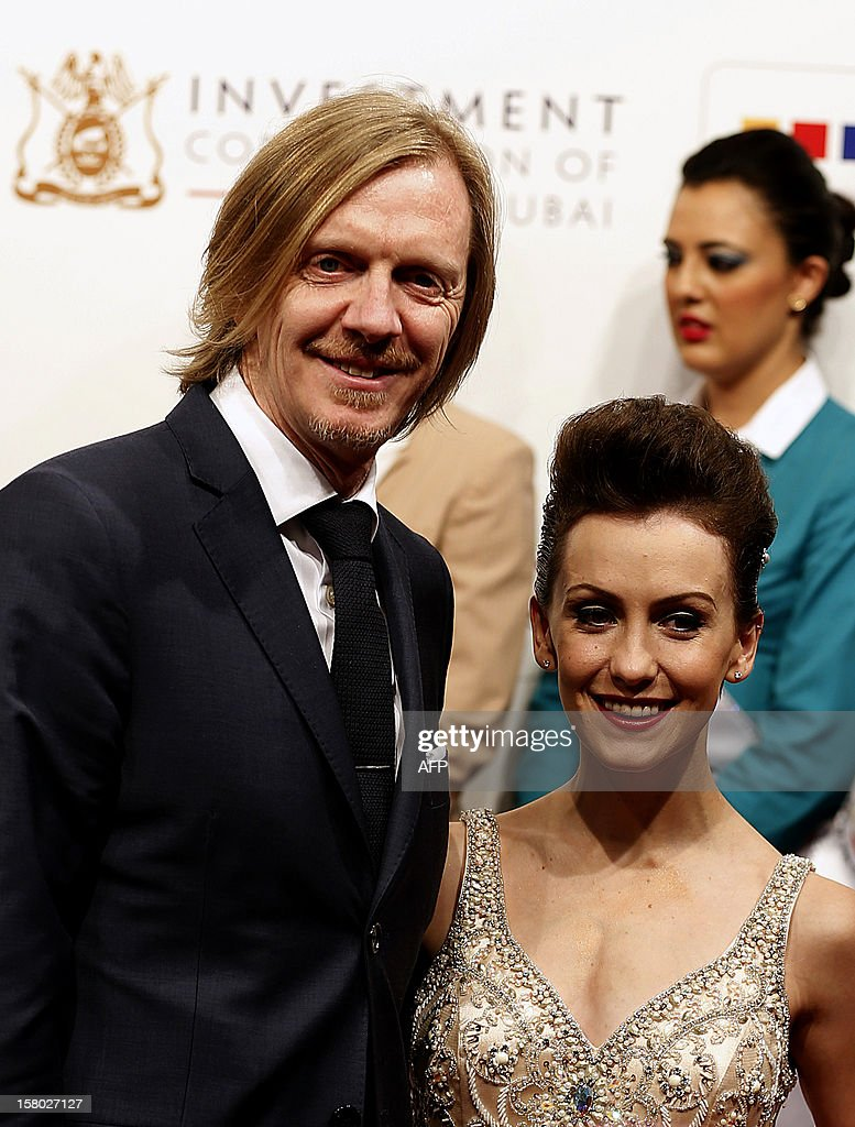 New Zealand film director Andrew Adamson and actress Erica Linz attends the Opening during day the Dubai International Film Festival in the Gulf emirate of Dubai on December 9, 2012.