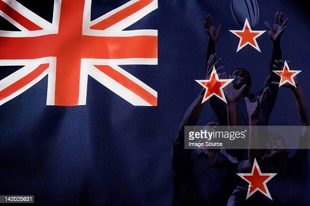New Zealand flag and rugby players