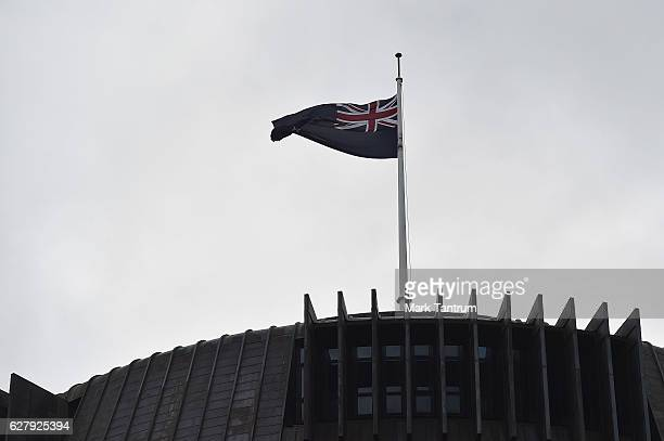 New Zealand flag on top of the Beehive on December 6 2016 in Wellington New Zealand Prime Minister John Key announced his surprise resignation as...