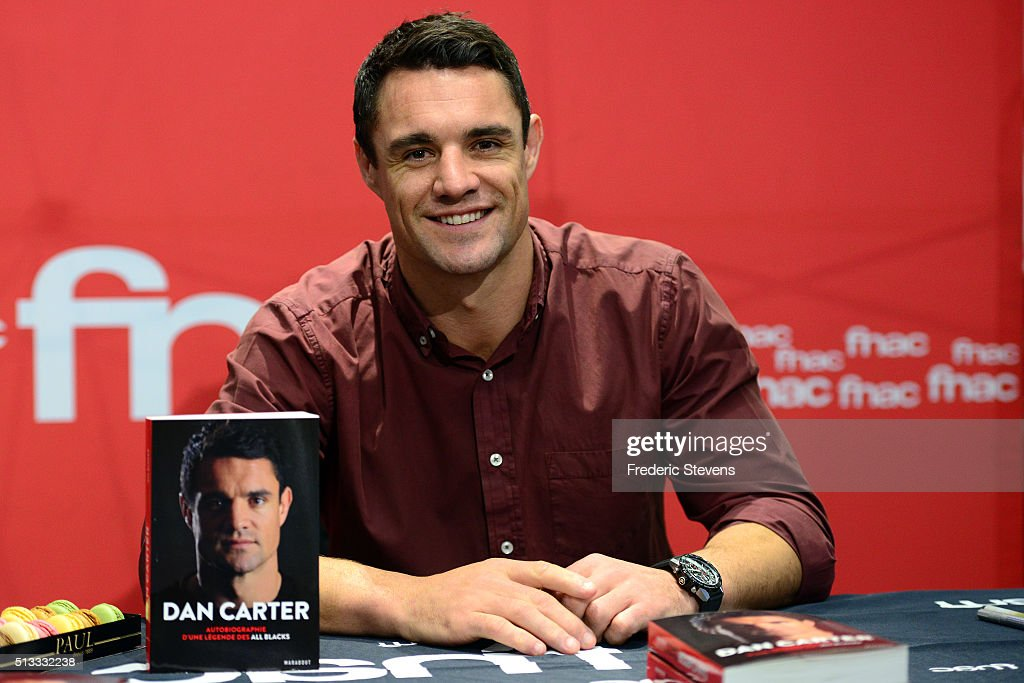 New Zealand flyhalf <a gi-track='captionPersonalityLinkClicked' href=/galleries/search?phrase=Dan+Carter+-+Rugby+Player&family=editorial&specificpeople=171299 ng-click='$event.stopPropagation()'>Dan Carter</a> poses during the book signing of his book '<a gi-track='captionPersonalityLinkClicked' href=/galleries/search?phrase=Dan+Carter+-+Rugby+Player&family=editorial&specificpeople=171299 ng-click='$event.stopPropagation()'>Dan Carter</a>: The Autobiography of an All Blacks Legend' at the French retail chain FNAC Champs Elysees on March 2, 2016 in Paris, France.