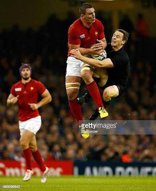New Zealand full back Ben Smith goes for a high ball with Louis Picamoles of France during the 2015 Rugby World Cup Quarter Final match between New...
