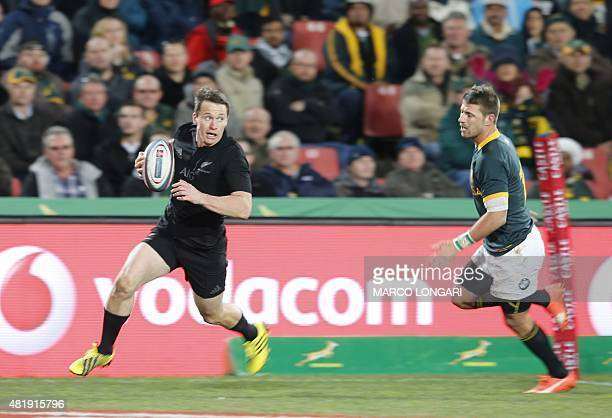 New Zealand fullback Ben Smith runs to score a try during the South Africa versus New Zealand match for the Castle Lager Rugby Championship in...
