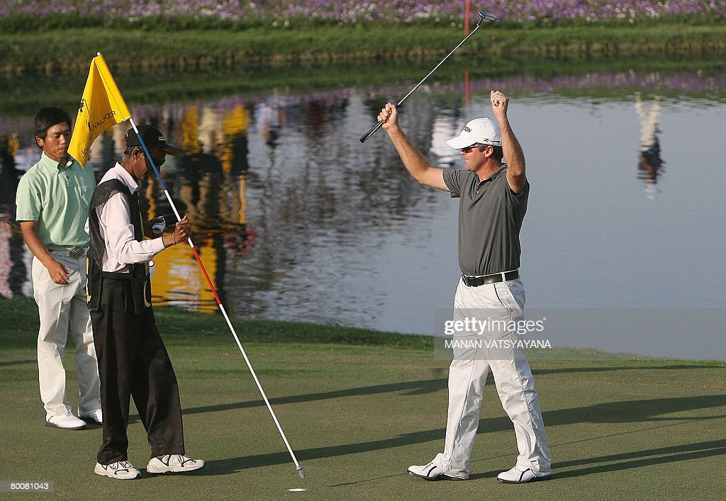 New Zealand golfer Mark Brown celebrates after finishing the eighteenth hole during the Johnnie Walker Classic 2008 in Gurgaon on the outskirts of...