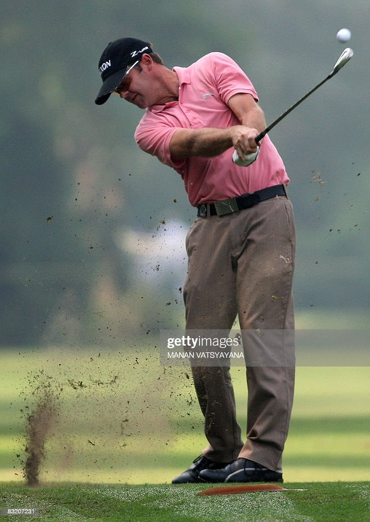 New Zealand golfer Mark Brown plays a fairway stroke towards the eighteenth green during the second round of the Hero Honda Indian Open at the Delhi...