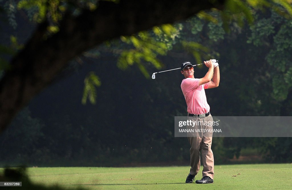 New Zealand golfer Mark Brown plays a fairway stroke towards the third green during the second round of the Hero Honda Indian Open at the Delhi Golf...