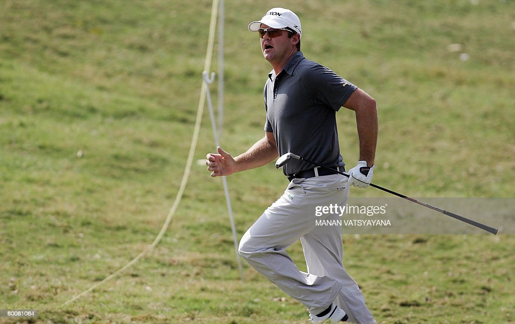 New Zealand golfer Mark Brown runs to watch after playing the drive during the final round of the Johnnie Walker Classic 2008 in Gurgaon on the...