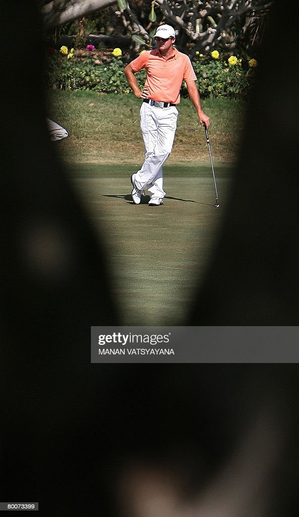 New Zealand golfer Mark Brown waits to take a putt on the seventeenth hole during the third round of the Johnnie Walker Classic 2008 in Gurgaon on...