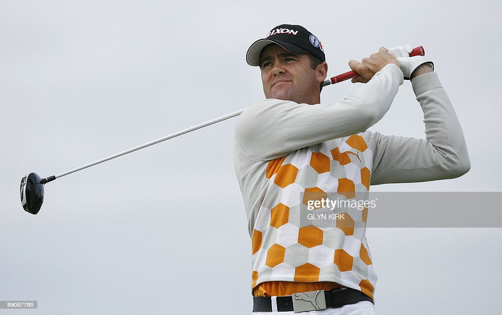 New Zealand golfer Mark Brown watches his drive on the 16th tee on the first day of the 138th British Open Championship at Turnberry Golf Course in...