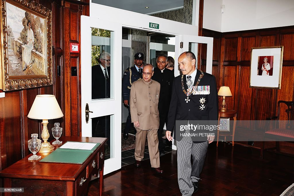 New Zealand Governor-General Jerry Mateparae welcomes Indian President Pranab Mukherjee following a welcome ceremony at Government House in Auckland on April 30, 2016. Mukherjee, the first Indian president to visit New Zealand, is on a three-day official visit. / AFP / POOL / Hannah Peters