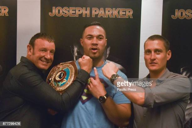 New Zealand heavyweight boxer Joseph Parker coach Kevin Barry and promoter David Higgins pose for camera after a press conference in Auckland on Nov...