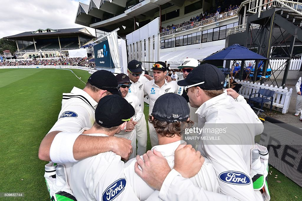New Zealand huddle during day two of the first cricket Test match between New Zealand and Australia at the Basin Reserve in Wellington on February 13, 2016. / AFP / Marty Melville