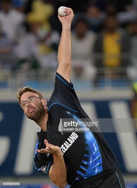New Zealand leftarm spinner Daniel Vettori delivers the ball during the second and last International T20 cricket match at Dubai International...