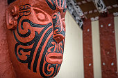 Traditional carving of an ancestral head at the entrance to a Rotorua meeting house in New Zealand.