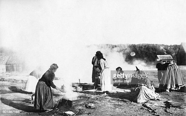 New Zealand Maori women cooking probably in the 1910's