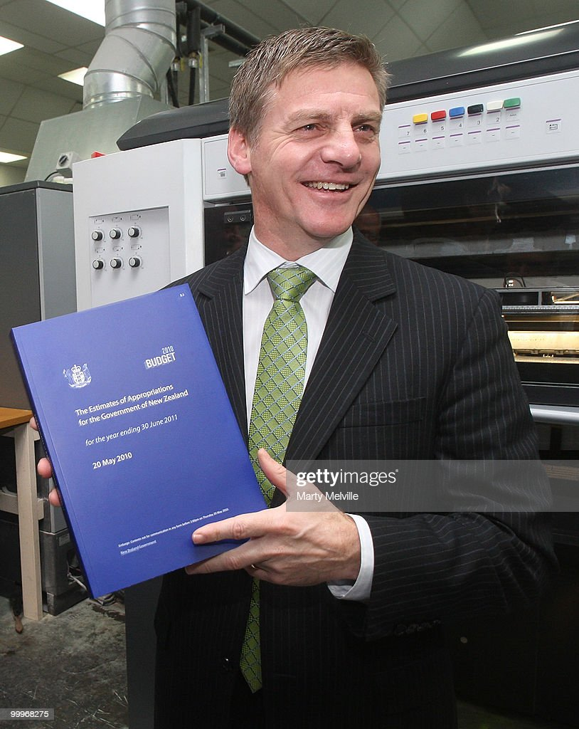 New Zealand Minister of Finance Bill English holds a copy of the budget during a visit to Printlink to oversee the printing of the Budget at Petone...